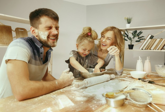 cute-little-girl-her-beautiful-parents-preparing-dough-cake-kitchen-home-family-lifestyle-concept