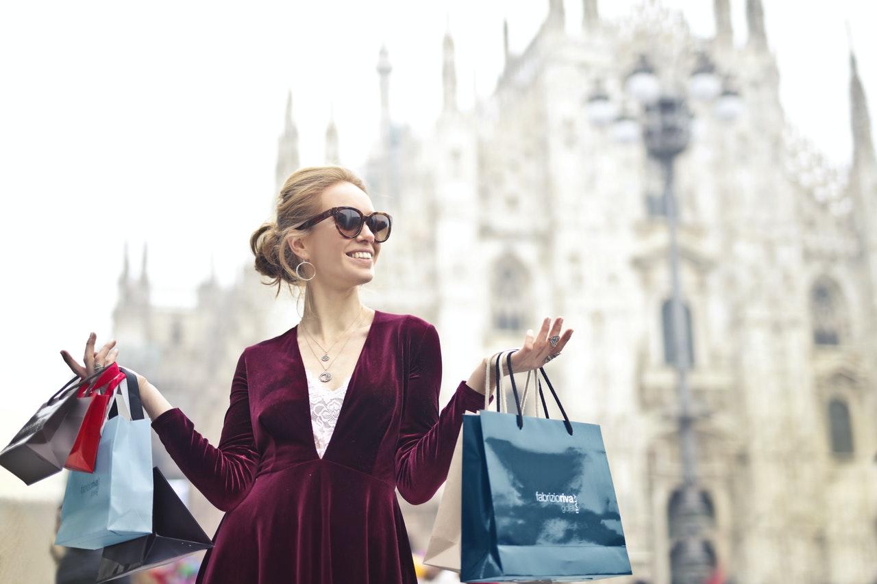 girl showing off shopping bags